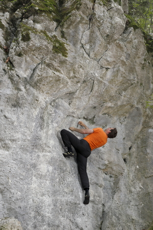 bouldering: bouldering man on a rock wall in europe