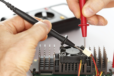 circuit brake: man is controlling an electrical component with tools Stock Photo