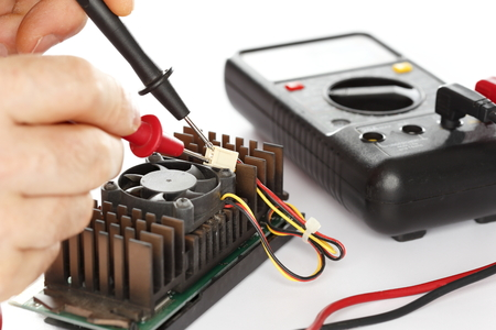 circuit brake: man is testing an electrical component with tools