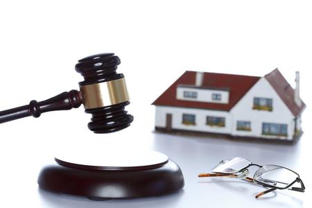 symbolic auction with house on white background Stock Photo