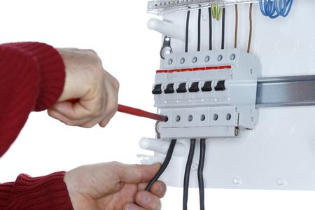 circuit brake: man works on distribution board, close up shot