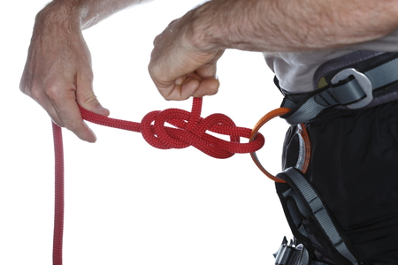 a climber is knotting a rope with hands photo