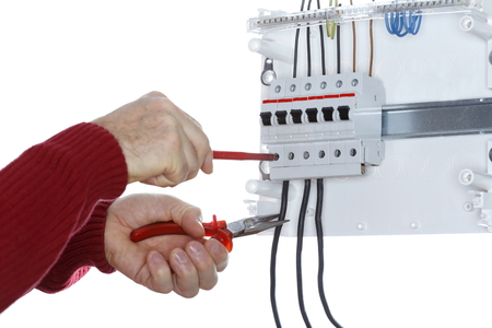 circuit brake: man works on an electrical  junction with white background