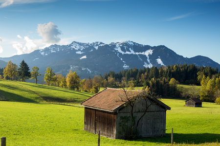 hovel: mountain landscape with hovel and green fields
