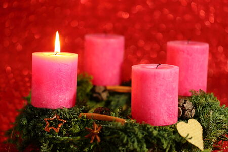 advent decoration with one flame on pink candle photo