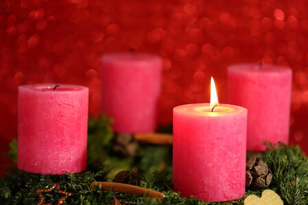 advent decoration with one flame on candle photo
