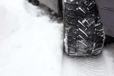 tread in the snow from car tire Stock Photo