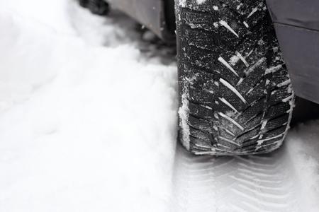 tire tread: tread in the snow from car tire Stock Photo
