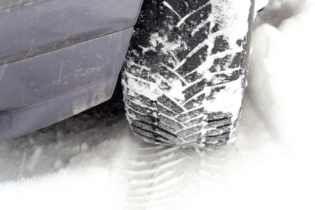 tread in the snow close up of car tire photo