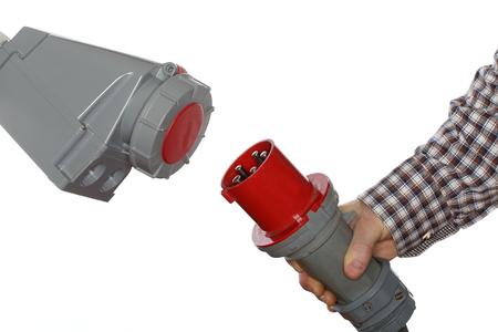 three phase: hand holds electrical plug, isolated on white background