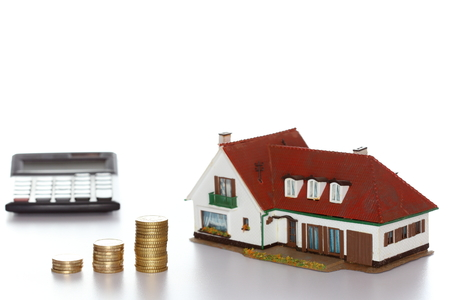 finance symbol with house and money coins photo