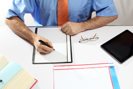 writing businessman on a modern office workplace photo