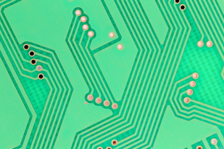 terabyte: close up of a green circuit board with printed lines Stock Photo
