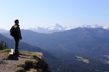 mountain hiker is looking to the bavarian alps Stock Photo