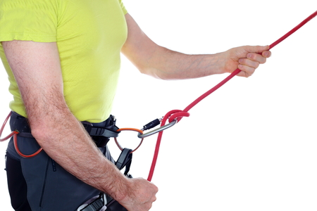 belaying: climber is belaying with red rope isolated on white background