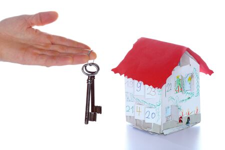 keyholder: house model and key on white background