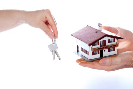 keyholder: taking a house model with key in hand