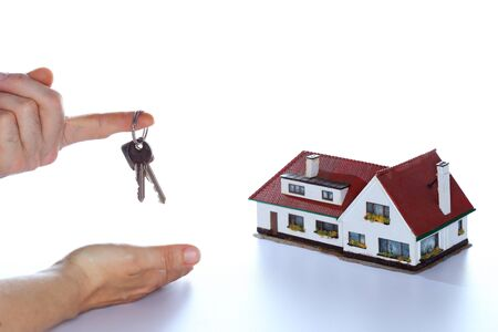 keyholder: symbolic selling a house with key in hand Stock Photo