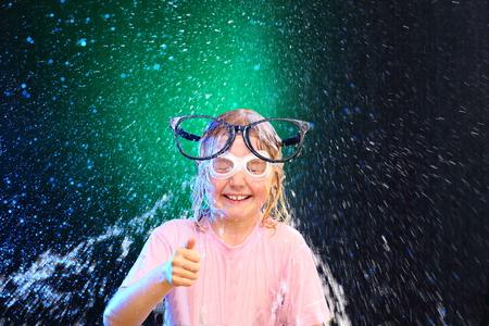 to watersplash: girl with glasses have  fun with watersplash