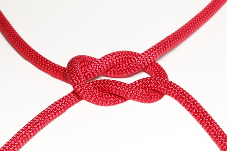 endings: red cross knot with four endings on white background