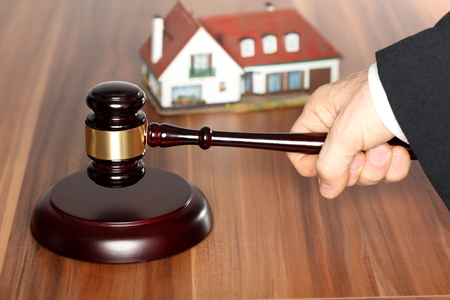 repossession: auction with hammer on a wooden table