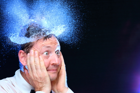 gloriole: surprised business man with blue water hat Stock Photo