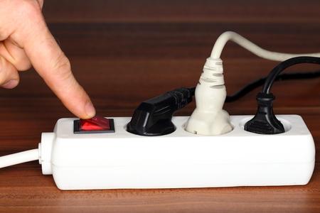 plug socket: symbolic energy saving with white plug socket Stock Photo