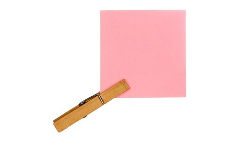 affixed: rose note paper with wooden peg on white background