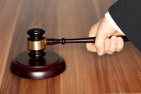 judgment: symbolic judgment with wooden hammer and table