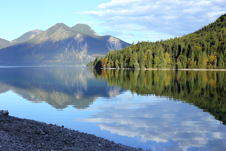reflecting: beauty reflecting lake in bavarian mountains at morning Stock Photo