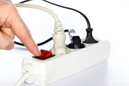 plug socket: finger is switching off a plug socket