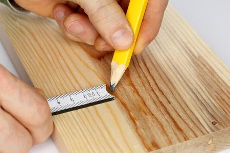 metering: closeup of writing on wood with metering scale