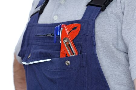 gripper: oil worker with gripper in his pocket Stock Photo