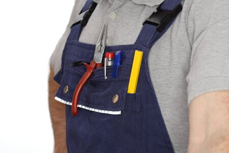 work wear: electrician with work wear and different tools