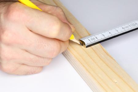 metering: metering scale and pen on wooden board