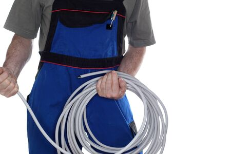work wear: a worker with work wear and cable Stock Photo