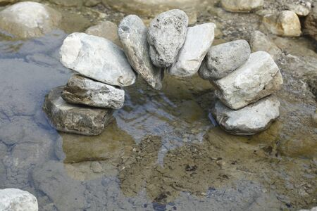 bridge over water: some stones formed as a bridge over water