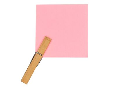 a wooden peg with a rose paper