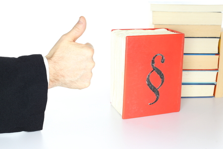 balance symbolic: government symbol with thumb up on desk Stock Photo