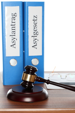 naturalization: two different folders with asylum and gavel