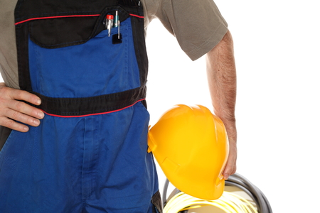work wear: worker with blue work wear and tools Stock Photo