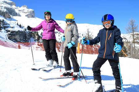 family is skiing in an italian resort