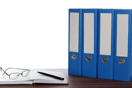 file folders: work desk with glasses and file folders