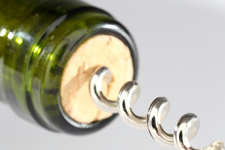 cork screw: green wine bottle with cork screw macro