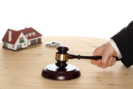 auctioneer: auctioneer with gavel in hand and car in background Stock Photo