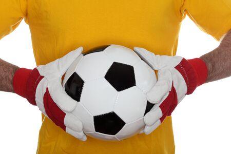 goal keeper: goal keeper is catching a soccer ball