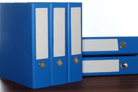 file folders: wooden board with some blue file folders Stock Photo
