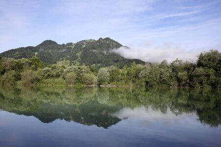 mirrored: beautiful landscape with mountains mirrored in lake Stock Photo