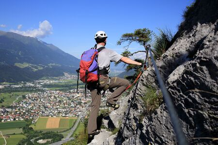 sport climber is viewing to the valley Stock Photo