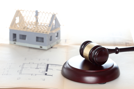 dept: auction symbol with gavel and house in background